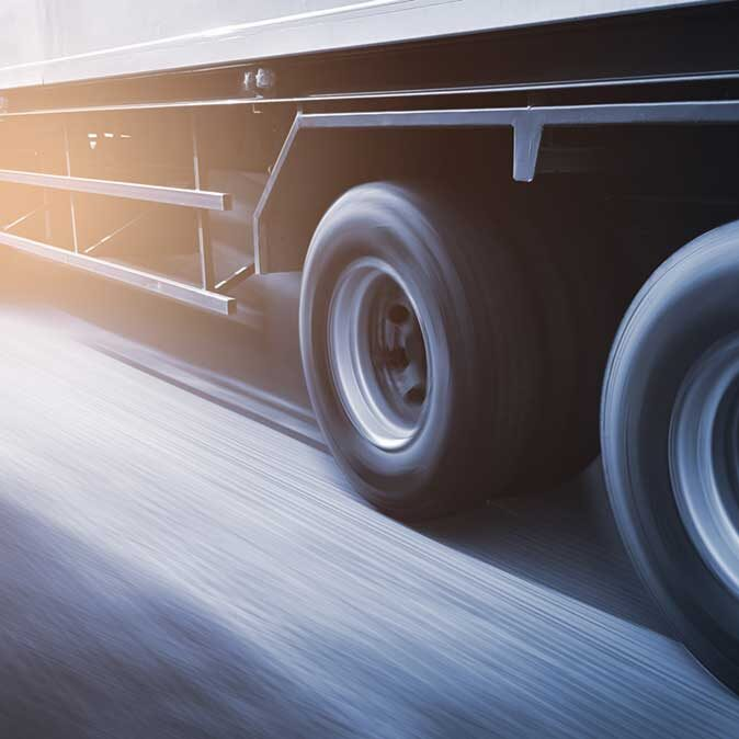 Speed Motion Blur Of Long Trailer Truck Driving On Road Sq